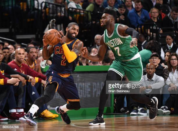 Kyrie Irving of the Cleveland Cavaliers handles the ball against Jaylen Brown of the Boston Celtics during the game on April 5 2017 at the TD Garden...