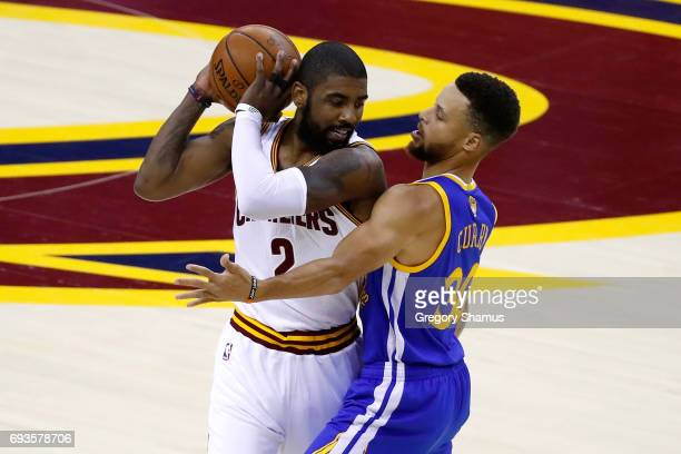 Kyrie Irving of the Cleveland Cavaliers handles the ball against Stephen Curry of the Golden State Warriors in the first quarter in Game 3 of the...