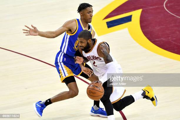 Kyrie Irving of the Cleveland Cavaliers handles the ball against Patrick McCaw of the Golden State Warriors in the first half in Game 3 of the 2017...
