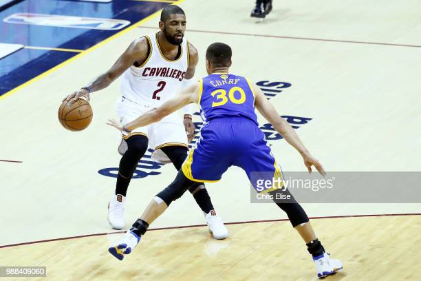 Kyrie Irving of the Cleveland Cavaliers handles the ball against Stephen Curry of the Golden State Warriors during Game Three of the 2016 NBA Finals...