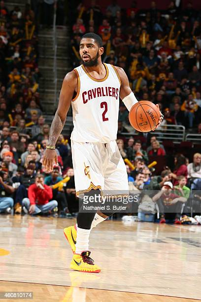 Kyrie Irving of the Cleveland Cavaliers handles the ball against the Minnesota Timberwolves during the game on December 23 2014 at Quicken Loans...