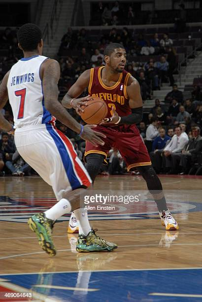 Kyrie Irving of the Cleveland Cavaliers handles the ball against the Detroit Pistons on February 12 2014 at The Palace of Auburn Hills in Auburn...