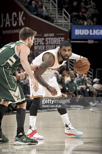 Kyrie Irving of the Cleveland Cavaliers handles the ball against the Milwaukee Bucks on December 21 2016 at The Quicken Loans Arena in Cleveland Ohio...