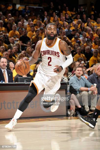 Kyrie Irving of the Cleveland Cavaliers handles the ball against the Toronto Raptors during Game Two of the Eastern Conference Semifinals of the 2017...