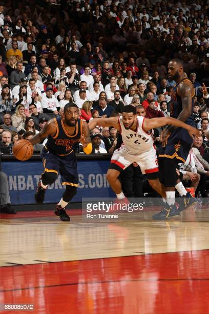 Kyrie Irving of the Cleveland Cavaliers handles the ball against the Toronto Raptors during Game Four of the Eastern Conference Semifinals of the...