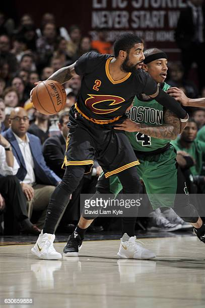 Kyrie Irving of the Cleveland Cavaliers handles the ball during a game against the Boston Celtics on December 29 2016 at Quicken Loans Arena in...