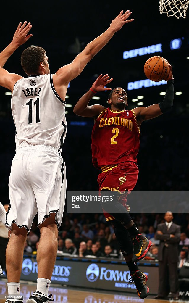 Kyrie Irving #2 of the Cleveland Cavaliers heads for the net as Brook Lopez #11 of the Brooklyn Nets defends on November 13, 2012 at the Barclays Center in the Brooklyn borough of New York City.