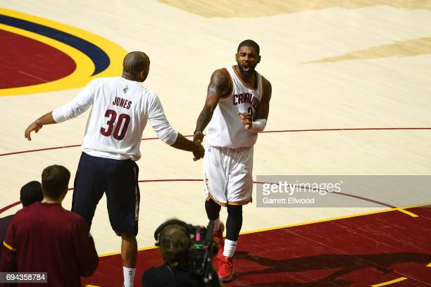 Kyrie Irving of the Cleveland Cavaliers high fives Dahntay Jones after defeating the Golden State Warriors in Game Four of the 2017 NBA Finals on...
