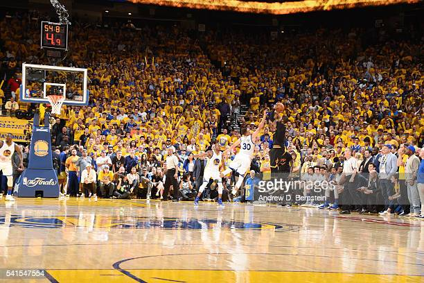 Kyrie Irving of the Cleveland Cavaliers hits the go ahead three pointer in Game Seven of the 2016 NBA Finals against Stephen Curry of the Golden...