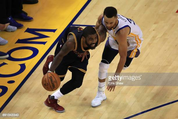 Kyrie Irving of the Cleveland Cavaliers is defended by Stephen Curry of the Golden State Warriors during the second half of Game 1 of the 2017 NBA...