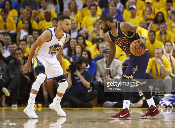 Kyrie Irving of the Cleveland Cavaliers is defended by Stephen Curry of the Golden State Warriors in Game 1 of the 2017 NBA Finals at ORACLE Arena on...