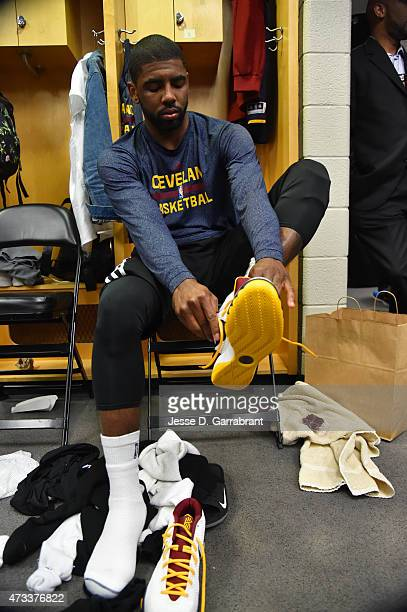 Kyrie Irving of the Cleveland Cavaliers laces up his sneakers prior to the game against the Chicago Bulls at the United Center before Game Six of the...