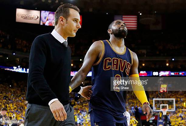 Kyrie Irving of the Cleveland Cavaliers leaves the game injured against the Golden State Warriors during Game One of the 2015 NBA Finals at ORACLE...