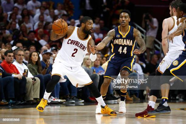 Kyrie Irving of the Cleveland Cavaliers looks to drive around Jeff Teague of the Indiana Pacers during the first half in Game Two of the Eastern...