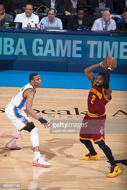 Kyrie Irving of the Cleveland Cavaliers looks to pass the ball against Russell Westbrook of the Oklahoma City Thunder during an NBA game on December...