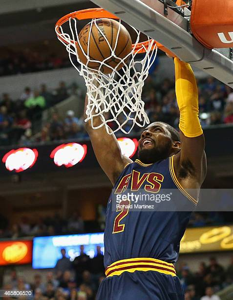 Kyrie Irving of the Cleveland Cavaliers makes the slam dunk against the Dallas Mavericks at American Airlines Center on March 10 2015 in Dallas Texas...