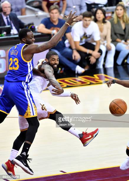 Kyrie Irving of the Cleveland Cavaliers passes against Draymond Green of the Golden State Warriors in the first quarter in Game 4 of the 2017 NBA...