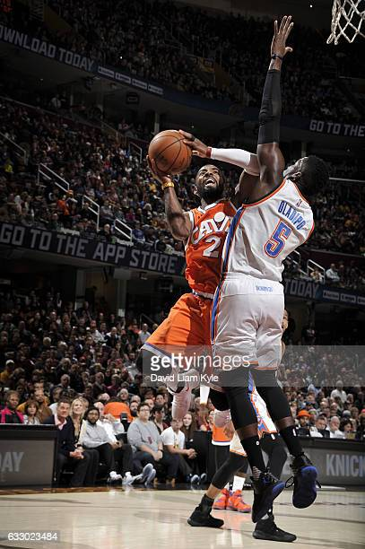 Kyrie Irving of the Cleveland Cavaliers passes the ball against Victor Oladipo of the Oklahoma City Thunder during the game on January 29 2017 at...