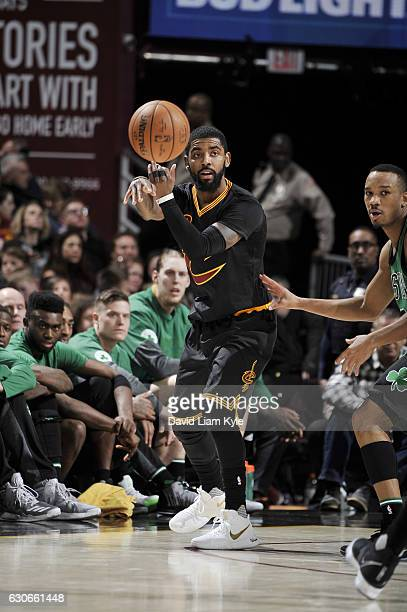 Kyrie Irving of the Cleveland Cavaliers passes the ball during a game against the Boston Celtics on December 29 2016 at Quicken Loans Arena in...