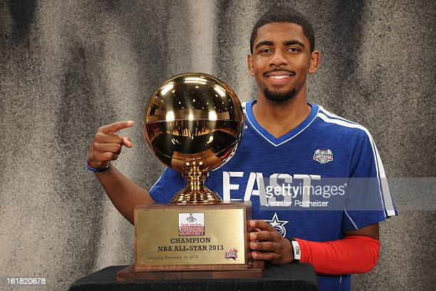 Kyrie Irving of the Cleveland Cavaliers poses for portraits with the 2013 Foot Locker ThreePoint Trophy during State Farm AllStar Saturday Night as...