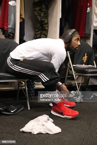 Kyrie Irving of the Cleveland Cavaliers puts his shoes on in the locker room before Game Five of the 2017 NBA Finals against the Golden State...