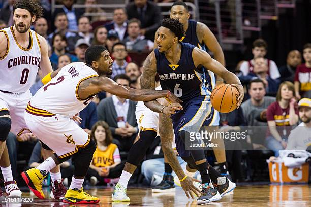 Kyrie Irving of the Cleveland Cavaliers puts pressure on Mario Chalmers of the Memphis Grizzlies during the second half at Quicken Loans Arena on...