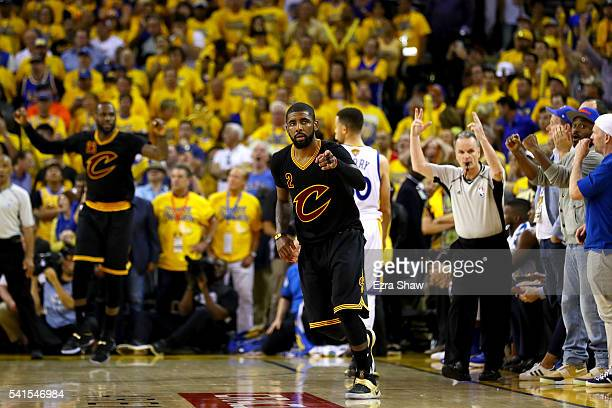 Kyrie Irving of the Cleveland Cavaliers reacts after a threepoint basket against the Golden State Warriors in Game 7 of the 2016 NBA Finals at ORACLE...