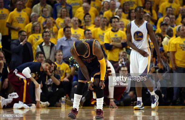 Kyrie Irving of the Cleveland Cavaliers reacts after being injured during Game One of the 2015 NBA Finals against the Golden State Warriors at ORACLE...
