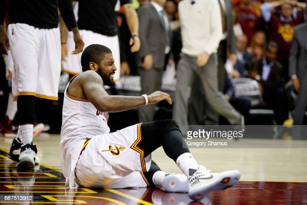Kyrie Irving of the Cleveland Cavaliers reacts after injuring his ankle in the third quarter against the Boston Celtics during Game Four of the 2017...