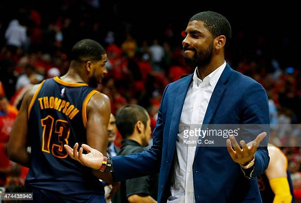 Kyrie Irving of the Cleveland Cavaliers reacts on the bench after Tristan Thompson dunked against the Atlanta Hawks in the fourth quarter during Game...