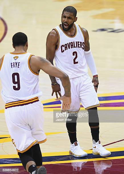 Kyrie Irving of the Cleveland Cavaliers reacts with Channing Frye during the first half against the Golden State Warriors in Game 3 of the 2016 NBA...