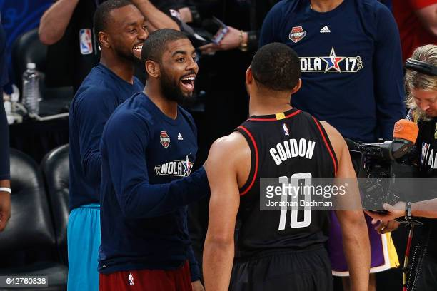 Kyrie Irving of the Cleveland Cavaliers reacts with Eric Gordon of the Houston Rockets during the 2017 JBL ThreePoint Contest at Smoothie King Center...