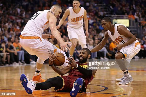 Kyrie Irving of the Cleveland Cavaliers recovers a turnover ahead of Alex Len Devin Booker and Brandon Knight of the Phoenix Suns during the first...