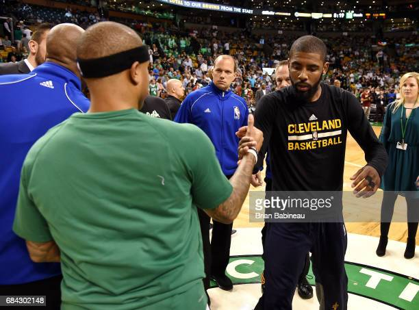 Kyrie Irving of the Cleveland Cavaliers shakes hands with Isaiah Thomas of the Boston Celtics before the game during Game One of the Eastern...