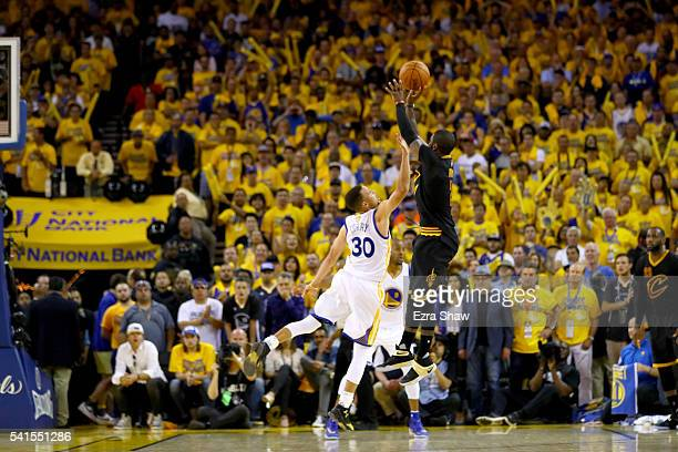 Kyrie Irving of the Cleveland Cavaliers shoots a threepoint basket late in the fourth quarter against the Golden State Warriors in Game 7 of the 2016...