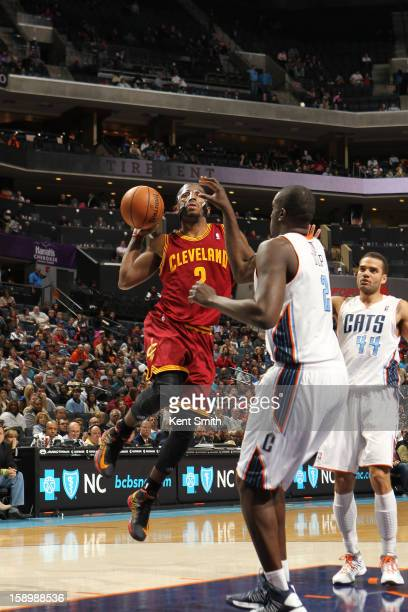 Kyrie Irving of the Cleveland Cavaliers shoots against DeSagana Diop of the Charlotte Bobcats at the Time Warner Cable Arena on January 4 2013 in...