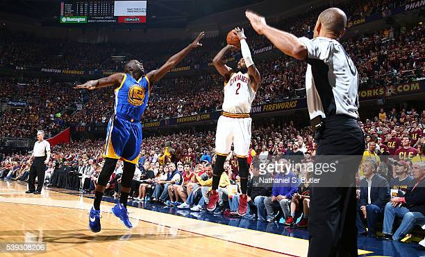 Kyrie Irving of the Cleveland Cavaliers shoots against Draymond Green of the Golden State Warriors during Game Four of the 2016 NBA Finals on June 10...