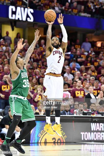 Kyrie Irving of the Cleveland Cavaliers shoots against Marcus Smart of the Boston Celtics in the second half during Game Three of the 2017 NBA...