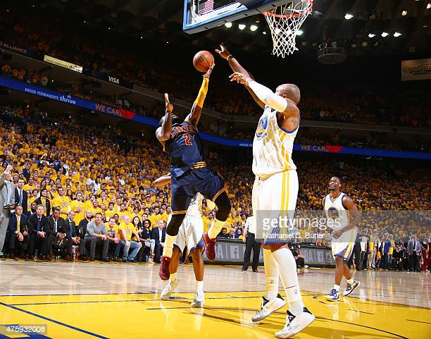 Kyrie Irving of the Cleveland Cavaliers shoots against Marreese Speights of the Golden State Warriors during Game One of the 2015 NBA Finals on June...