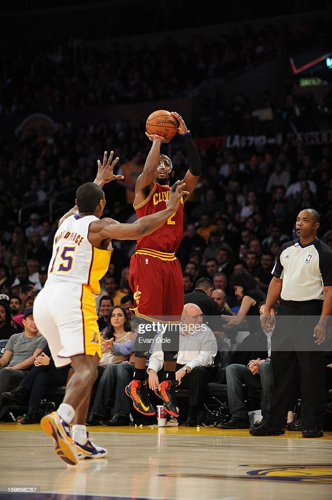 Kyrie Irving #2 of the Cleveland Cavaliers shoots against Metta World Peace #15 of the Los Angeles Lakers at Staples Center on January 13, 2013 in Los Angeles, California.