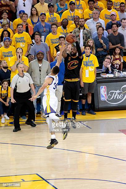 Kyrie Irving of the Cleveland Cavaliers shoots for three against Stephen Curry of the Golden State Warriors in Game Seven of the 2016 NBA Finals on...
