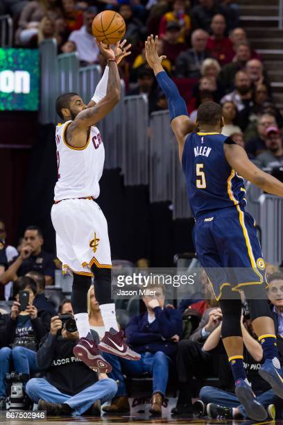Kyrie Irving of the Cleveland Cavaliers shoots over Lavoy Allen of the Indiana Pacers during the first half at Quicken Loans Arena on April 2 2017 in...