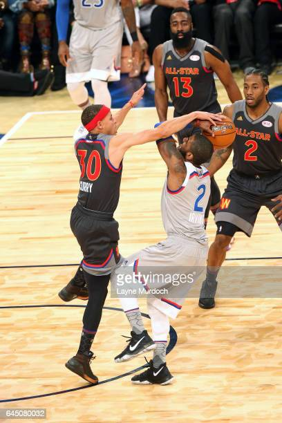 Kyrie Irving of the Cleveland Cavaliers shoots the ball against Stephen Curry of the Golden State Warriors during the NBA AllStar Game as part of the...