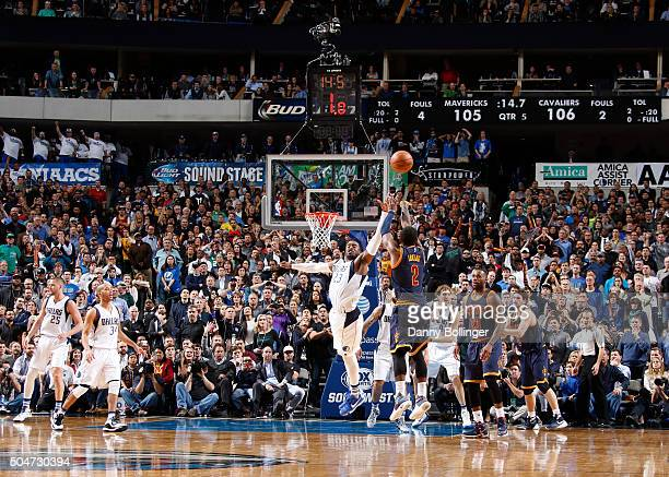 Kyrie Irving of the Cleveland Cavaliers shoots what would be the game clinching shot against the Dallas Mavericks on January 12 2016 at the American...
