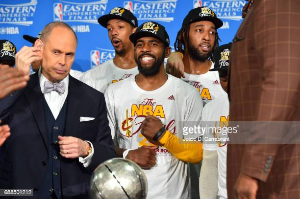 Kyrie Irving of the Cleveland Cavaliers smiles big while presented the Eastern Conference Finals trophy after their victory against the Boston...