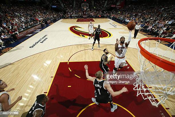 Kyrie Irving of the Cleveland Cavaliers takes a shot against the Brooklyn Nets at The Quicken Loans Arena on December 19 2014 in Cleveland Ohio NOTE...