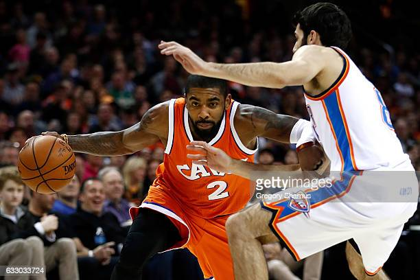 Kyrie Irving of the Cleveland Cavaliers tries to drive around Alex Abrines of the Oklahoma City Thunder during the second half at Quicken Loans Arena...