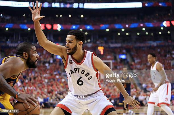 Kyrie Irving of the Cleveland Cavaliers tries to get past Cory Joseph of the Toronto Raptors in the first half of Game Six of the Eastern Conference...