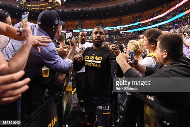 Kyrie Irving of the Cleveland Cavaliers walks off the court after Game Two of the Eastern Conference Finals against the Boston Celtics during the...