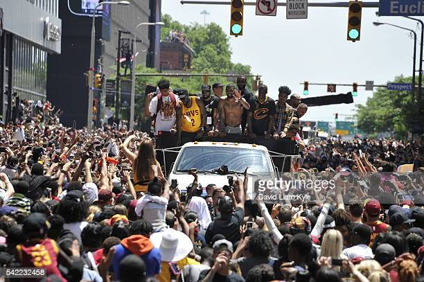Kyrie Irving of the Cleveland Cavaliers waves to the fans during the Cleveland Cavaliers Victory Parade And Rally on June 22 2016 in downtown...
